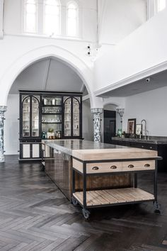 A masterful melding of old world craftsmanship and contemporary design, this London church conversion by interior designer Harriet Holgate and the bespoke furniture specialists at Rupert Beven Ltd. Diy Flooring, Kitchen Flooring, Flooring Ideas, Küchen Design, House Design, Church Conversions, Kitchen Trolley, Kitchen Island, Interior Architecture