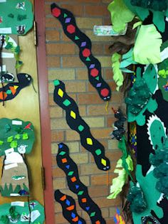 Pattern snake craft for Rainforest theme... just use long black paper and colorful shapes