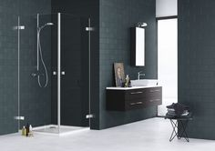 The AIR shower series is designed with a simple floating expression. Here the two doors solution is combined with a dark oak Calidris vanity unit. Tall Cabinet Storage, Locker Storage, Joko, Vanity Units, Shower Enclosure, Bathroom Furniture, Bathtub, Mirror, Retro