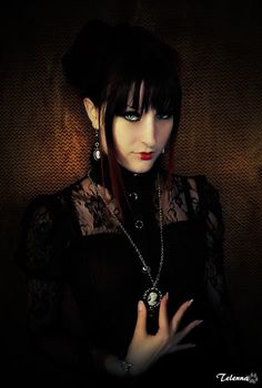 Goth with very beautiful hands...so charming.
