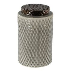 """Ceramic lidded vase in grey with raised honeycomb detailing.  Product: Vase and lidConstruction Material: CeramicColor: Grey and bronzeFeatures: Honeycomb detailingDimensions: 12"""" H x 7.5"""" Diameter"""