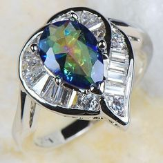 'Rainbow & White Topaz Gems 14kt W.GoldF' is going up for auction at 11pm Sun, Aug 26 with a starting bid of $6.