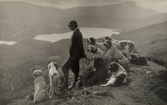 Dogs help a Scottish gamekeeper keep watch in Aberfoyle, Scotland, March 1919.Photograph by William Reid, National Geographic