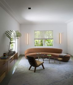 Living room with Vladimir Kagan sofa in Miami art deco villa remodel by Stephan Weishaupt, owner of Avenue Road, Max-Zambelli-photo | Remodelista