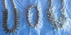 Set your jewelry between two sheets of plastic wrap to prevent it from moving around and tangling inside your bag.