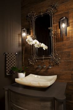 This bathroom has contemporary, Old-World, glamorous, regency, Asian and even a hint of rustic style going on, and it all balances out to equal one stunner of a room.