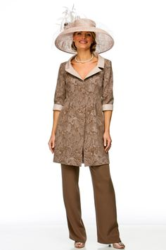 Flattering neckline on short embroidered coat worn over dress, skirt or trousers as pictured. Choice of colours.