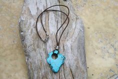This absolutely beautiful turquoise magnesite necklace will introduce a splash of cool color into your look. The blue turquoise magnesite pendant hangs from a soft greek leather cord that measures 18 inches and hooks with a silver plated lobster clasp.  This necklace ships in a gift box ready for giving.  Thank you for shopping and supporting artists
