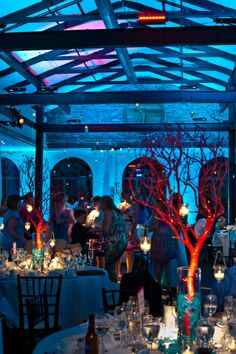 wedding with red coral centerpiece and teal blue lighting - Reminds me of an aquarium. I like it.