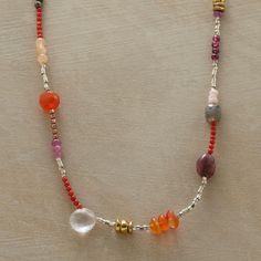 """FESTIVA NECKLACE--Our vibrant, hand strung gala of gems is lit with sparkling rose quartz, tourmaline, pyrite, coral, carnelian, opal, labradorite, sapphire, garnet, moonstone, sterling silver and copper beads. Toggle clasp. Handmade. Exclusive. Approx. 34""""L."""