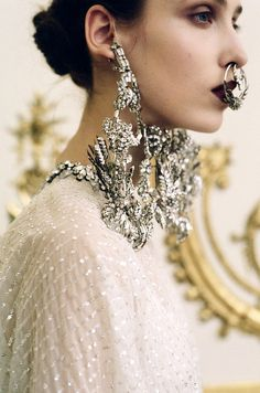Givenchy, couture S/S 12 --complete with giant hoop diamond nose rings!!