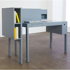 The desk is comprised of two components – the main working area and a free-standing storage unit that can lean on the desk from two sides.