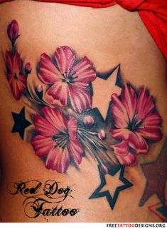 Flowers and stars tattoo on a girl's back