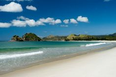 Explore the white sands of pretty Kaitoke Beach, on Great Barrier Island's east coast.