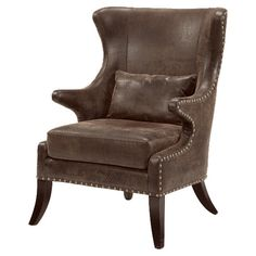 Wingback arm chair with saber legs and nailhead trim.   Product: ChairConstruction Material: Wood and microfiber