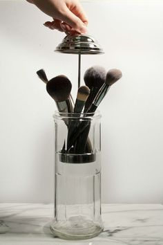 A vintage straw dispenser means dust-free makeup brushes. (Plus, it's pretty… A vintage straw dispenser means dust-free makeup brushes. (Plus, it's pretty AF. Makeup Storage Hacks, Makeup Brush Storage, Makeup Brush Holders, Makeup Brush Set, Makeup Organization, Makeup Brush Organizer, Vintage Makeup Storage Ideas, Makeup Kit Hacks, Beauty Storage Ideas
