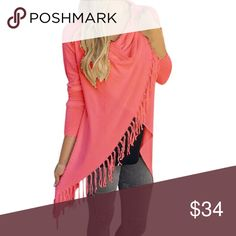 Asymmetrical Comfy Pink Tassel Poncho Sweater NWT in original packing. Top rated item! 🌟Coral. Tassel detail with single button at top. Comfortably fits one size smaller than tag size. Perfect for end of summer/early fall vibes! An absolute stunner! Sweaters Shrugs & Ponchos