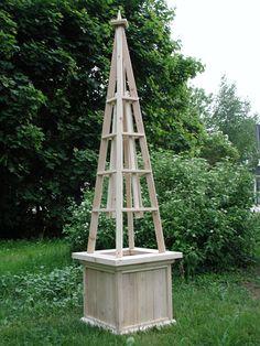 small obelisk planter details- centre of garden focal point