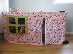 Kids play house, just old sheets (a little sewing) and a table. My girls would love this.
