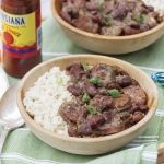 Put this classic Red Beans and Rice in a thermos and bring it to your parade route picnic. You'll be glad that you did.