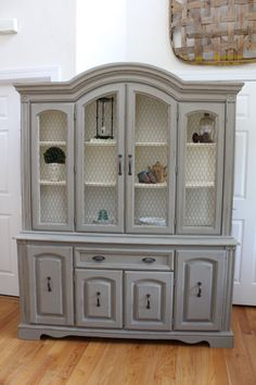 Grey china cabinet with white interior. No chicken wire though