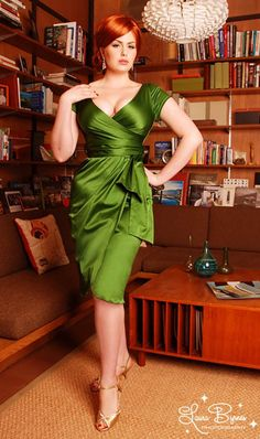 I wish I had a fancy pants party to go to so I could have an excuse to buy this dress. SEXY MUCH? also, love how they styled the model after Joan from Mad Men.