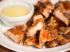 Filipino lechon kawali is one of the great pork dishes of the world, and the only hard thing about making it is waiting for the boiled pork belly to air-dry in the fridge overnight before being fried until intensely crisp and crunchy on the outside and meltingly tender within.