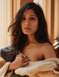 Ready for her closeup, Freida Pinto wears a wavy hairstyle