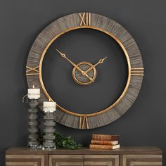 Charcoal stained fir wood with antiqued gold accents, Roman numerals, and floating center dial give the Alphonzo wall clock a decidedly distinctive design. Big and bold, this timepiece will look great above a fireplace, in a dining room, office, or as a focal point in your living room.