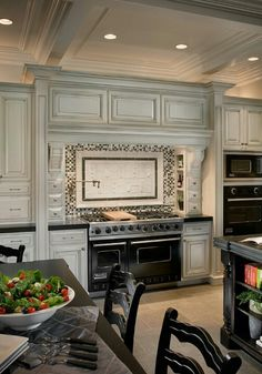 Fabulous kitchen with black range & countertop