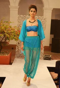 Turquoise-green chiffon jacket (INR 3290) and bandeau-bra (INR1690) worn over a net blouson-skirt (INR 1900)over a skirt with lace hem detailing (INR 1890)