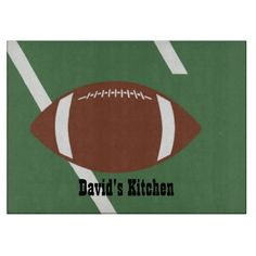 Football Cutting Board ............This design features a football on a football field. The TEXT can be customized with your own name. Great for anyone who loves football.
