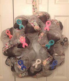 Cancer Wreath!  My favorite!!  It was made in memory of and in celebration of those I love who are fighting cancer, beat cancer, or lost their battle!