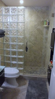 Glass block bathroom shower wall. So fun!