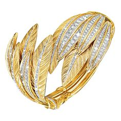 "Verdura ""Tiara"" Gold & Diamond Feather Cuff Bracelet ""Tiara"" feather cuff bracelet in yellow gold and platinum with diamond accents. Gems Jewelry, Jewelry Art, Fine Jewelry, Fashion Jewelry, Jewelry Bracelets, Bangle Bracelet, Necklaces, Diamond Tiara, Diamond Cuts"