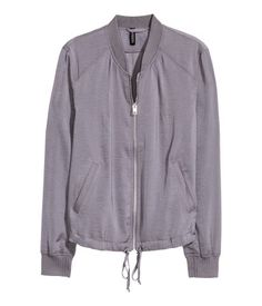 Grey. Bomber jacket in airy satin with a zip down the front, side pockets, drawstring at the hem and ribbing around the collar, cuffs and hem. Unlined.