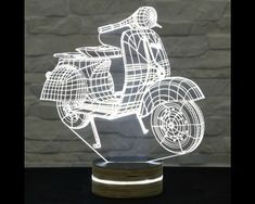 This Vespa scooter shaped 3D LED lamp has an amazing effect. You can use it as home and office decor, table lamp, night light etc. It creates different ambience in your rooms.. Innovative LED...