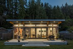 Located in one of the Puget Sound's most scenic island communities, this home takes full advantage of sweeping water views and provides an ideal retreat from city life. With personal touches such as a reclaimed barn door and chalkboard wall, it is both family-friendly and sophisticated.