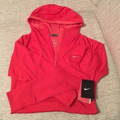 NIKE HOODIE Nike running hoodie in Red polyester/wool with a soft mesh interior lining (see last pic). Snap front closure, thumb holes & reflectors on the back. Small pen sized marking on the back from handling, barely noticeable (may wash out). Brand new w tags! Nike Tops Sweatshirts & Hoodies