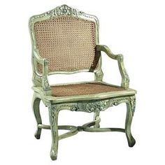 "Handmade carved mahogany wood accent chair with double caned panels and a woven rush seat.    Product: Chair   Construction Material: Mahogany and rush   Color: Green   Features: Hand-painted   Dimensions: 38"" H x 26"" W x 20"" D"
