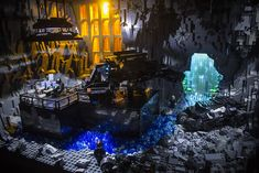 Inspired by the Dark Knight Rises Batcave, some liberties had to be taken due to the lack of parts and to ensure all the details were visible from a forward viewing angle. Batman Batcave, Im Batman, Lego Batman, Batman History, Lego Dragon, Cool Minecraft Houses, Minecraft Buildings, Lego Display, Amazing Lego Creations