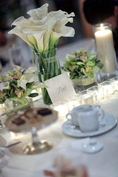 White Calla Lilly reception wedding flowers, wedding decor, wedding flower centerpiece, wedding flower arrangement, add pic source on comment and we will update it. www.myfloweraffair.com can create this beautiful wedding flower look.