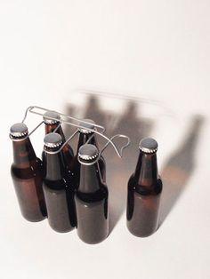 oooms   sixpack bottle carrier (via http://pinterest.com/pin/2351893/)
