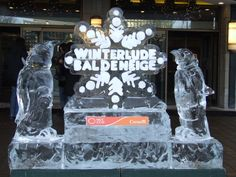 An ice sculpture of the Winterlude logo and two penguins. I don't care what anyone says - ICE SCULPTURES ROCK!