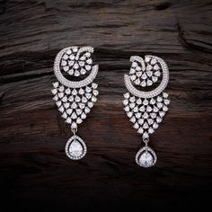 Fashionable CZ Zircon Hanging earrings studded with White synthetic stones, with Gold Polish.