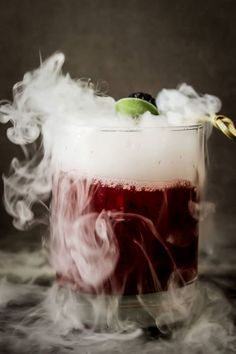 Smoking Blackberry Sage Margarita: No spells needed to create this flavorful drink. Just wait until the dry ice melts before taking the first sip. Click through to find more easy Halloween cocktail recipes for a crowd.