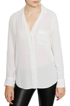 """The Keira Blouse is a pajama inspired shirt featuring a slight oversized fit, v-neck, flat collar, lapel and chest pocket. This blouse features a black polka dot print, great for the office or a night out with friends.  Measures: 28.5"""" L  Keira Dot Print Top by Equipment. Clothing - Tops Canada"""