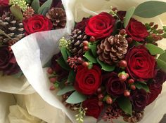 Red Rose, hypericum and dark green foliage. this, but with purple and Burgundy tones so it doesn't scream xmas... No white or ivory