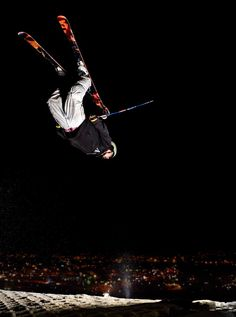 Fearless skier jumping through air with a night city scene in the background, Ski Centre Stoke. Ski And Snowboard, Snowboarding, Skiing, City Scene, Night City, Extreme Sports, Lifestyle Photography, Stars, Movie Posters