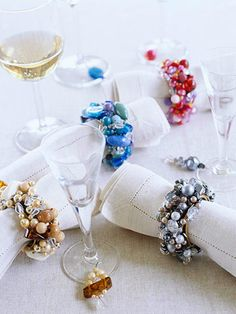 Beautiful Beaded Napkin Rings  Ordinary metal napkin rings morph into gem-encrusted beauties when you thread beads and crystals onto craft wire and wrap it securely around the rings. Thread more beads onto wire to make a coordinating set of wineglass charms.